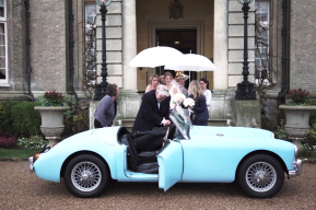 Rainy Wedding Day Louisa exit, Hedsor House Wedding Video by Destination and Buckinghamshire Wedding Videographers Kissing Gate